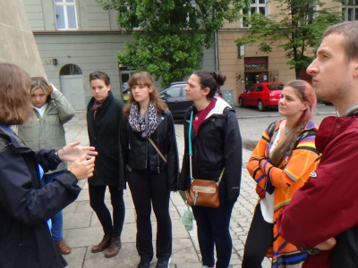 SRAS students exploring Warsaw, Poland with a guide